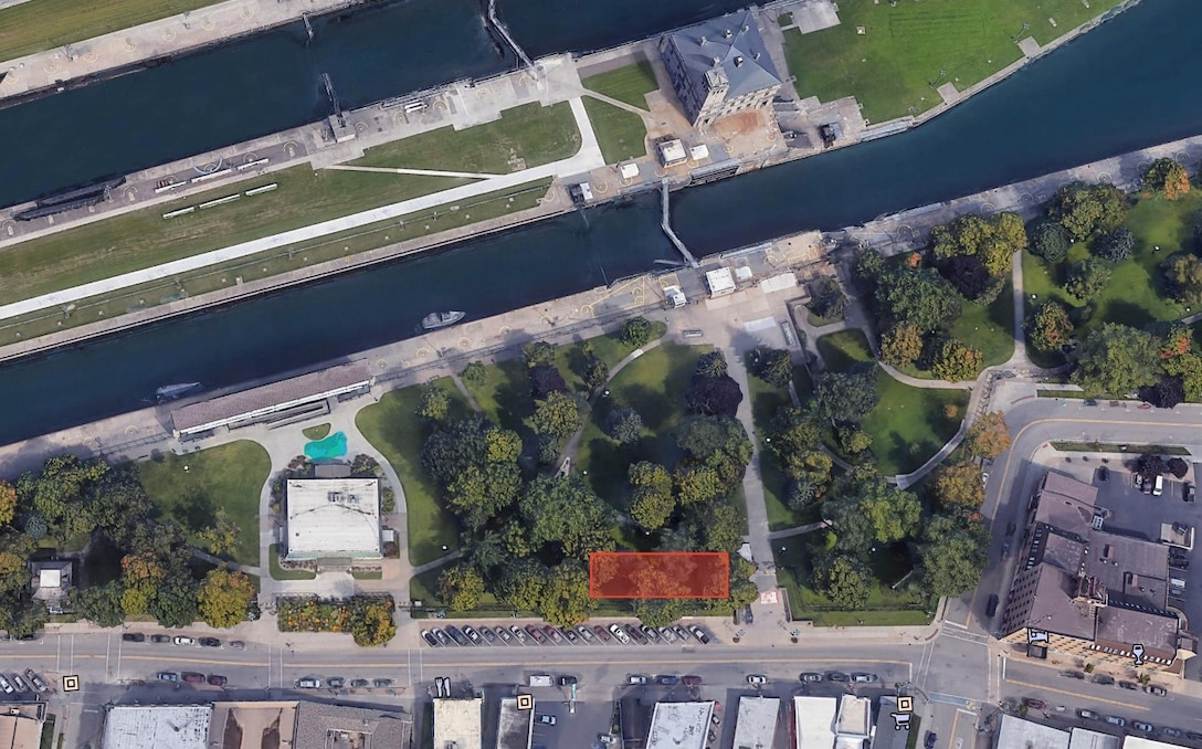 The highlighted area shows the proposed location for a 50-foot by 120-foot temporary office space in Canal Park on the Soo Locks property in Sault Ste. Marie, Michigan. The proposed one-story structure will house Corps employees overseeing the New Lock at the Soo project construction. Project officials say it will have an attractive, semi-permanent look, unlike a typical construction site.