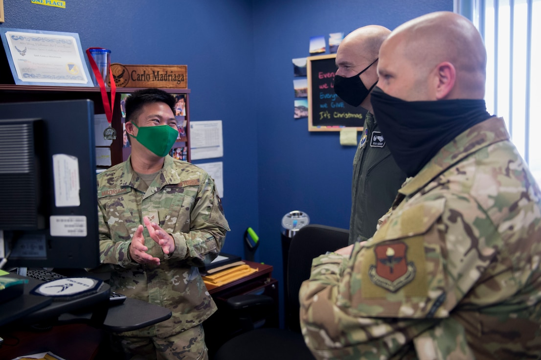 (From left to right) Senior Airman Carlo Madriaga, 311th Fighter Squadron commander support staff member, Col. Ryan Keeney, 49th Wing commander and Chief Master Sgt. Thomas Temple, 49th WG command chief, discuss amenities from an Airmen's perspective, Dec. 21, 2020, on Holloman AFB, New Mexico. Keeney and Temple routinely visit various work centers on base to see the Holloman mission in action and check-in with the Airmen of the 49th Wing. (U.S. Air Force photo by Airman 1st Class Quion Lowe)