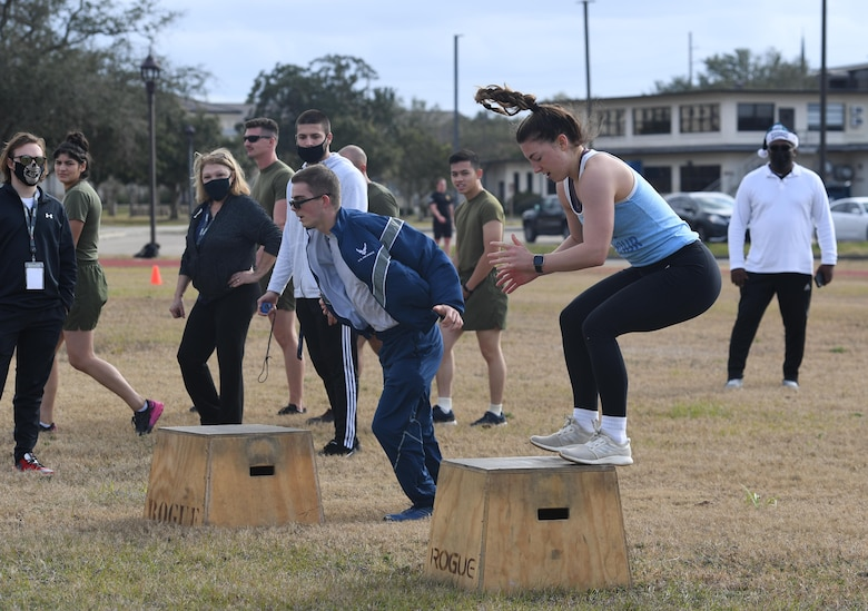 U.S. Air Force Airmen Teagan Day, 336th Training Squadron, and Bailey Woods, 334th Training Squadron, participate in a reindeer games fitness challenge at Keesler Air Force Base, Mississippi, Dec. 23, 2020. The 81st Training Group held various events for Airmen to participate in throughout the holidays, to include ice skating, inflatables, a scavenger hunt and a bubble ball soccer tournament. (U.S. Air Force photo by Kemberly Groue)