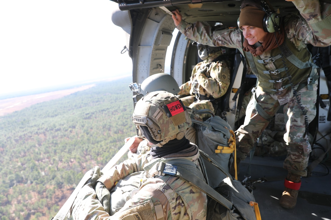 U.S. Army paratroopers jumping from a UH-60 Black Hawk at Sicily Drop Zone, Fort Bragg, N.C., Dec. 3, 2020, during non-tactical airborne operations hosted by the Army Reserve's U.S. Army Civil Affairs and Psychological Operations Command (Airborne) and the 82nd Airborne Division.