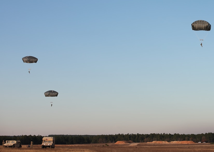 U.S. Army paratroopers jump from a UH-60 Black Hawk at Sicily Drop Zone, Fort Bragg, N.C., Dec. 3, 2020, during non-tactical airborne operations hosted by the U.S. Army Reserve's U.S. Army Civil Affairs and Psychological Operations Command (Airborne) and the 82nd Airborne Division.