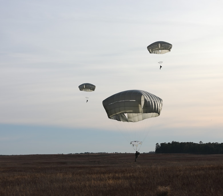 U.S. Army paratroopers jumping from UH-60 Black Hawk aircraft navigate Sicily Drop Zone to a safe landing at Fort Bragg, N.C., Dec. 3, 2020, during non-tactical airborne operations hosted by the U.S. Army Reserve's U.S. Army Civil Affairs and Psychological Operations Command (Airborne) and the 82nd Airborne Division.