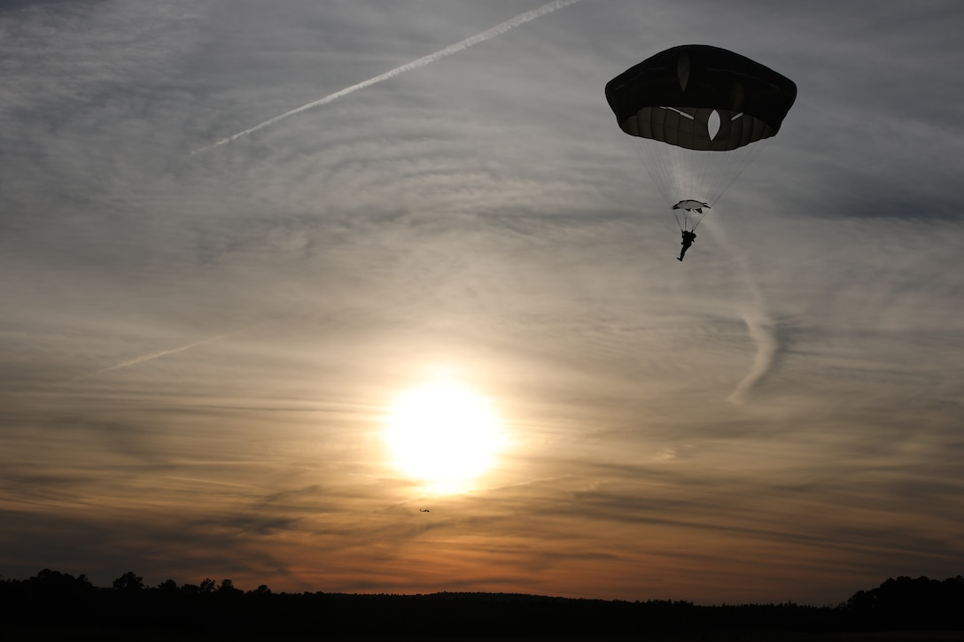A U.S. Army paratrooper navigates to a safe landing at Sicily Drop Zone, Fort Bragg, N.C., Dec. 3, 2020, during non-tactical airborne operations hosted by the U.S. Army Reserve's U.S. Army Civil Affairs and Psychological Operations Command (Airborne) and the 82nd Airborne Division.