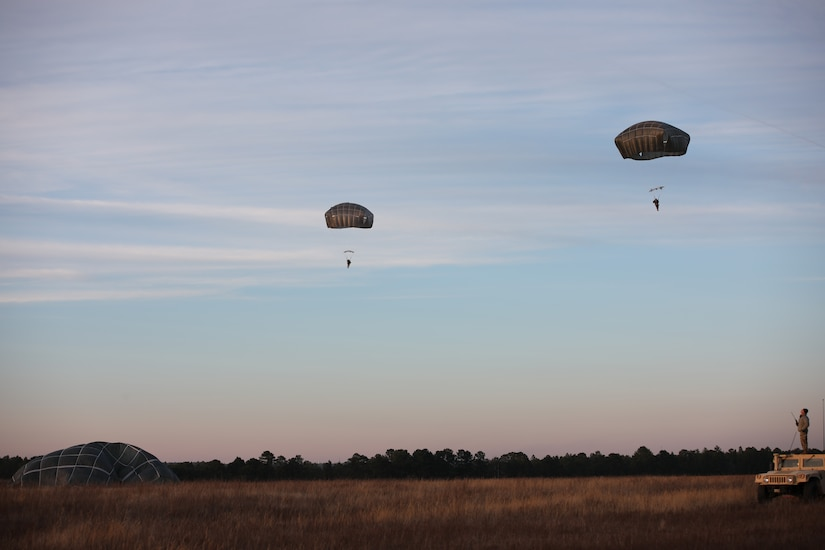 U.S. Army paratroopers navigate to a safe landing at Sicily Drop Zone, Fort Bragg, N.C., Dec. 3, 2020, during non-tactical airborne operations hosted by the U.S. Army Reserve's U.S. Army Civil Affairs and Psychological Operations Command (Airborne) and the 82nd Airborne Division.