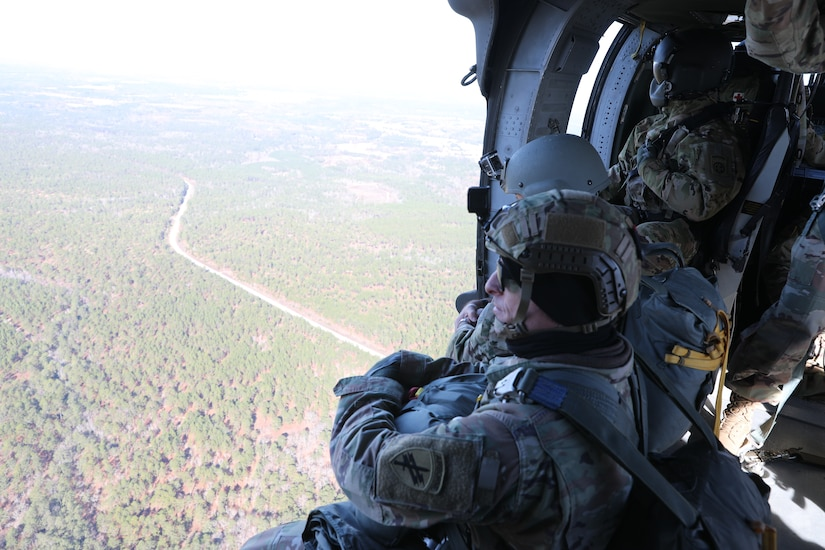 U.S. Army Reserve Maj. Sean P. Howen prepares to conduct airborne operations at Sicily Drop Zone, Fort Bragg, N.C., Dec. 3, 2020, during non-tactical airborne operations hosted by the U.S. Army Reserve's U.S. Army Civil Affairs and Psychological Operations Command (Airborne) and the 82nd Airborne Division.
