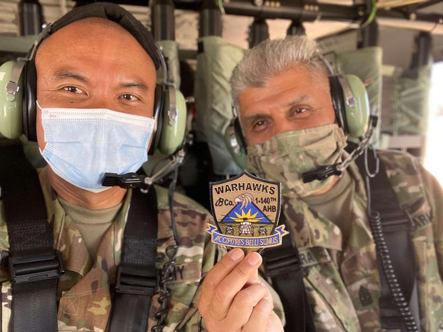 Two soldiers pose for a close-up photo together