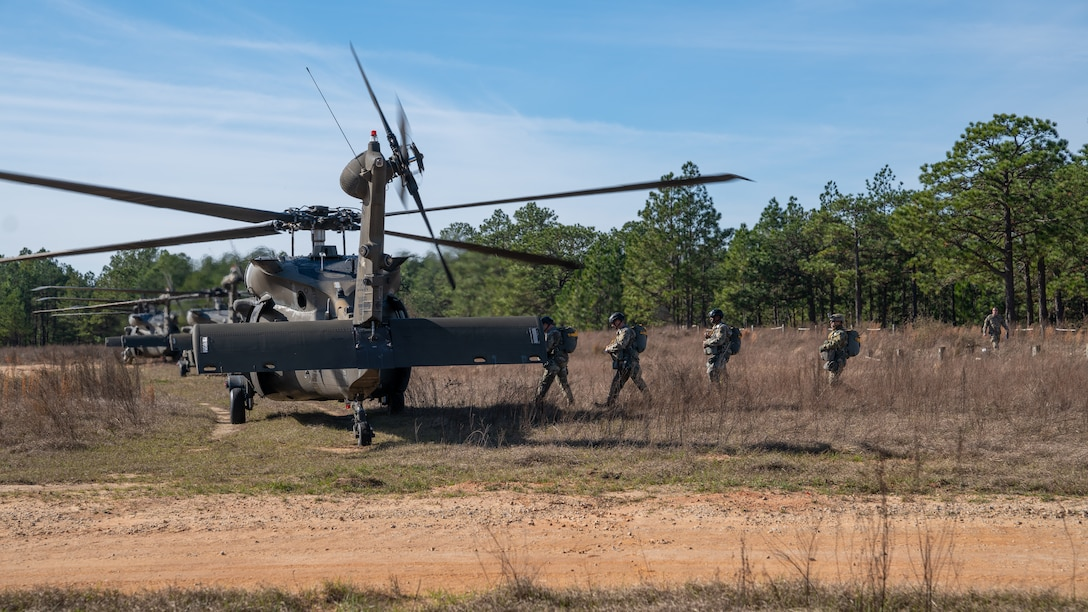 U.S. Army paratroopers prepare to conduct airborne operations at Sicily Drop Zone, Fort Bragg, N.C., Dec. 3, 2020, during non-tactical airborne operations hosted by the U.S. Army Reserve's U.S. Army Civil Affairs and Psychological Operations Command (Airborne) and the 82nd Airborne Division.