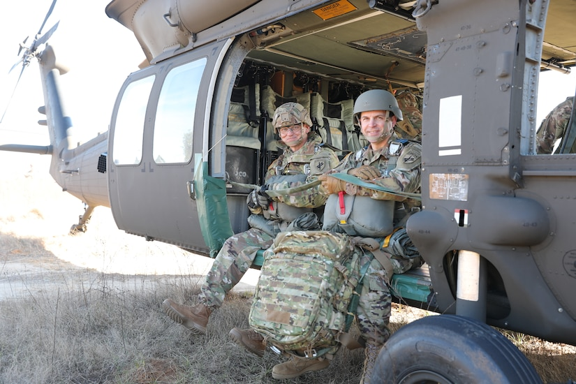 U.S. Army Reserve Brig. Gen. Michael M. Greer (left), U.S. Army Civil Affairs and Psychological Operations Command (Airborne) deputy commanding general, and Col. Thomas C. Akerlund (right), U.S. Army Civil Affairs and Psychological Operations Command (Airborne) G1, prepare to conduct airborne operations at Sicily Drop Zone, Fort Bragg, N.C., Dec. 3, 2020, during non-tactical airborne operations hosted by the U.S. Army Reserve's USACAPOC(A) and the 82nd Airborne Division.