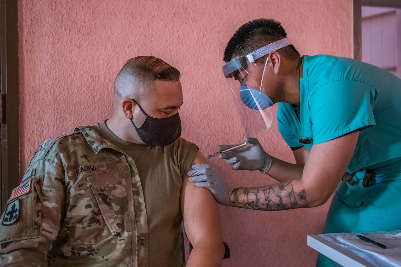 A soldier gets inoculated with the COVID-19 vaccine.