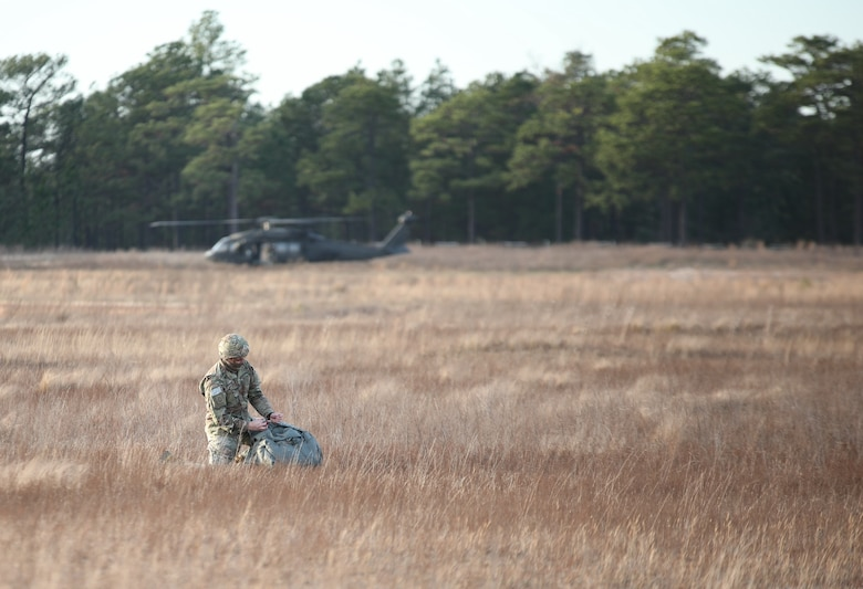 A U.S. Army paratrooper packs his parachute after a jump from UH-60 Black Hawk aircraft at Sicily Drop Zone at Fort Bragg, N.C., Dec. 3, 2020, during non-tactical airborne operations hosted by the U.S. Army Reserve's U.S. Army Civil Affairs and Psychological Operations Command (Airborne) and the 82nd Airborne Division.