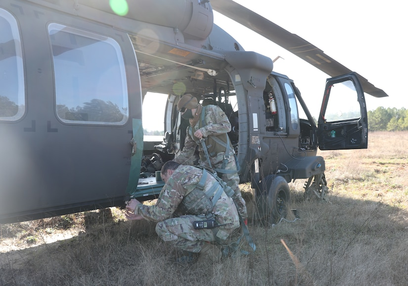 U.S. Army paratroopers prepare to conduct airborne operations at Sicily Drop Zone, Fort Bragg, N.C., Dec. 3, 2020, during non-tactical airborne operations hosted by the Army Reserve's U.S. Army Civil Affairs and Psychological Operations Command (Airborne) and the 82nd Airborne Division.