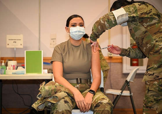 Service member receives COVID vaccination.