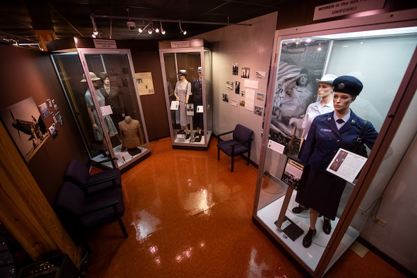 The WAF gallery consists of mannequins dressed in various WAF uniforms from the 40s through the 80s, photos and artifacts.
