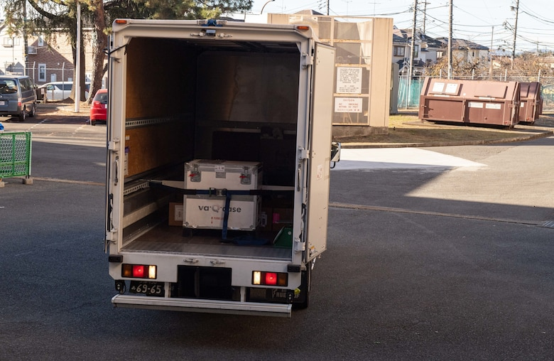 A delivery truck arrives with the first wave of Moderna COVID-19 vaccines at Yokota Air Base