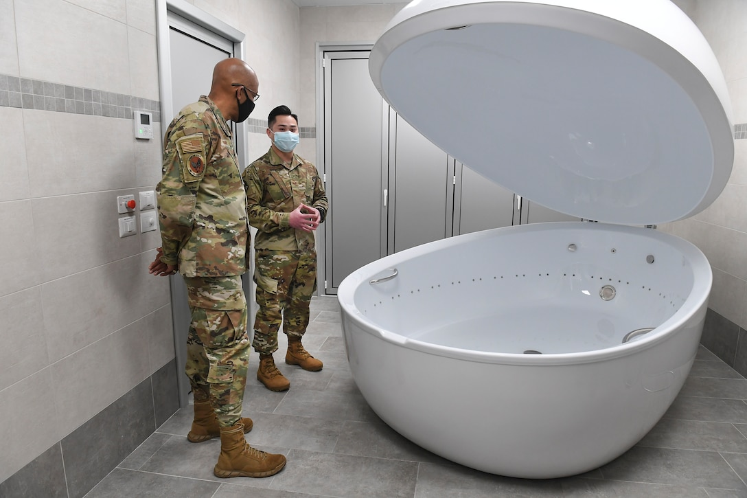 Air Force Chief of Staff Gen. Charles Q. Brown, Jr. tours the Comprehensive Operational Medicine for Battle Ready Airmen (COBRA) Clinic and receives briefs about several different programs at Aviano Air Base, Italy, Dec. 23, 2020. During the tour of the clinic, Brown was shown a sensory deprivation tank and was briefed on new innovative ideas, such as incorporating diagnosis, recovery, rehabilitation, and performance optimization into a single unified mission.  (U.S. Air Force photo by Staff Sgt. Valarie Halbert)