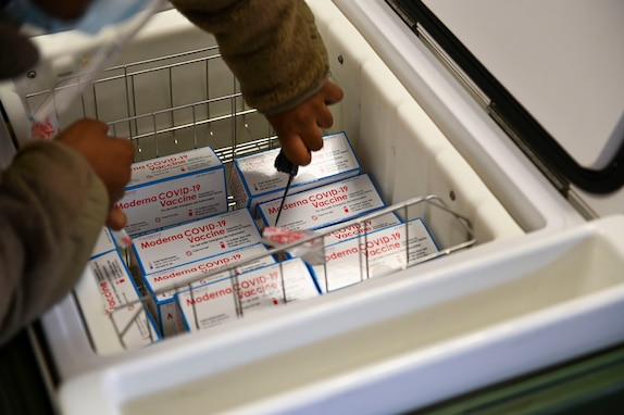 U.S. Air Force Senior Airman Shaneshia Lindsey, 51st Medical Support Squadron medical materiel technician, unpacks COVID-19 vaccines at Osan Air Base, Republic of Korea, Dec. 28, 2020.