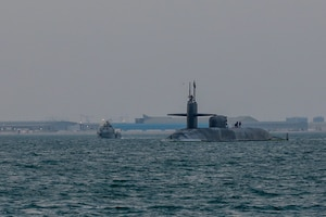 201227-A-RX269-1066 GULF OF BAHRAIN (Dec. 27, 2020) The guided-missile submarine USS Georgia (SSGN 729) transits the Gulf of Bahrain, outbound from a sustainment and logistics visit in Manama, Bahrain, Dec. 27. Georgia is deployed to the U.S. 5th Fleet area of operations in support of naval operations to ensure maritime stability and security in the Central Region, connecting the Mediterranean and Pacific through the Western Indian Ocean and three critical chokepoints to the free flow of global commerce.
