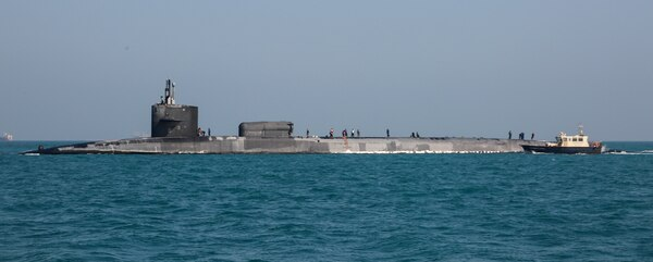 201223-A-HS292-1020 GULF OF BAHRAIN (Dec. 23, 2020) The guided-missile submarine USS Georgia (SSGN 729) transits the Gulf of Bahrain, inbound to a sustainment and logistics visit in Manama, Bahrain, Dec. 23. Georgia is deployed to the U.S. 5th Fleet area of operations in support of naval operations to ensure maritime stability and security in the Central Region, connecting the Mediterranean and Pacific through the Western Indian Ocean and three critical chokepoints to the free flow of global commerce.