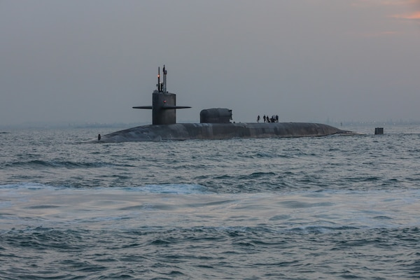 201227-A-RX269-1182 GULF OF BAHRAIN (Dec. 27, 2020) The guided-missile submarine USS Georgia (SSGN 729) transits the Gulf of Bahrain, outbound from a sustainment and logistics visit in Manama, Bahrain, Dec. 27. Georgia is deployed to the U.S. 5th Fleet area of operations in support of naval operations to ensure maritime stability and security in the Central Region, connecting the Mediterranean and Pacific through the Western Indian Ocean and three critical chokepoints to the free flow of global commerce.