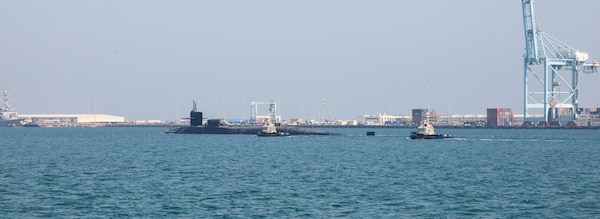 201223-A-HS292-1033 GULF OF BAHRAIN (Dec. 23, 2020) The guided-missile submarine USS Georgia (SSGN 729) transits the Gulf of Bahrain, inbound to a sustainment and logistics visit in Manama, Bahrain, Dec. 23. Georgia is deployed to the U.S. 5th Fleet area of operations in support of naval operations to ensure maritime stability and security in the Central Region, connecting the Mediterranean and Pacific through the Western Indian Ocean and three critical chokepoints to the free flow of global commerce.