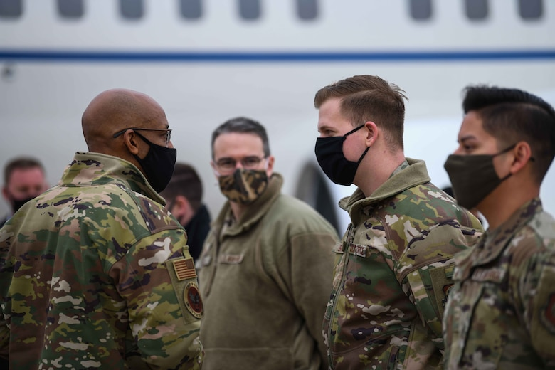 Air Force Chief of Staff Gen. Charles Q. Brown, Jr., speaks to an Airmen from the 31st Fighter Wing before he departs Aviano Air Base, Italy, Dec. 23, 2020. During his visit he connected with Airmen and toured Aviano Air Base to emphasize the importance of the 31st FW's mission. (U.S. Air Force photo by Airman 1st Class Ericka A. Woolever)