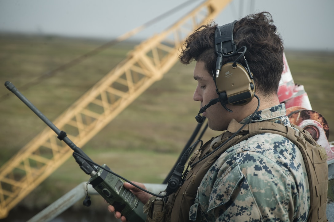 U.S. Marine Lance Cpl. Peter Tubiolo, a radio operator with Second Air-Naval Gunfire Liaison Company (2D ANGLICO) conducts a radio check during a Joint Terminal Attack Controller training exercise at Bombing Target 11, at Piney Island, North Carolina, Oct. 20, 2020. 2D ANGLICO's mission is to provide Marine Air Ground Task Force commanders a liaison capability with foreign area expertise to plan, coordinate, employ and conduct terminal control of fires in support of joint, allied and coalition forces. (U.S. Marine Corps photo by Lance Cpl. Michael Neuenhoff)