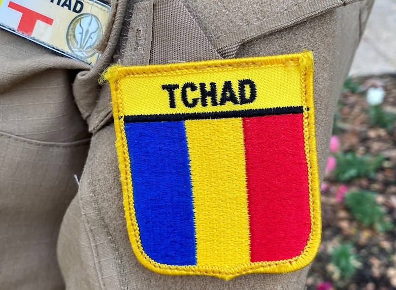 The Republic of Chad flag is shown on the uniform of one of the first two women in that service to become a pilot.