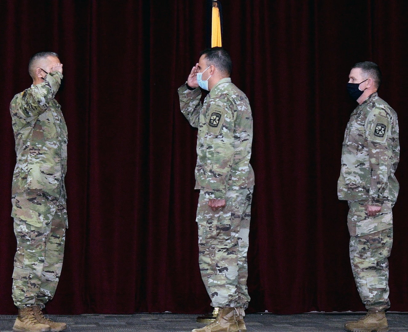 (From left) Incoming Command Sgt. Maj. Jose M. Salas, 5th Brigade, U.S. Army Cadet Command, salutes Col. Mark A. Olsen, 5th Brigade commander, as outgoing Command Sgt. Maj. George B. Bunn looks on during achange of responsibility ceremony at Joint Base San Antonio-Fort Sam Houston Dec. 18.