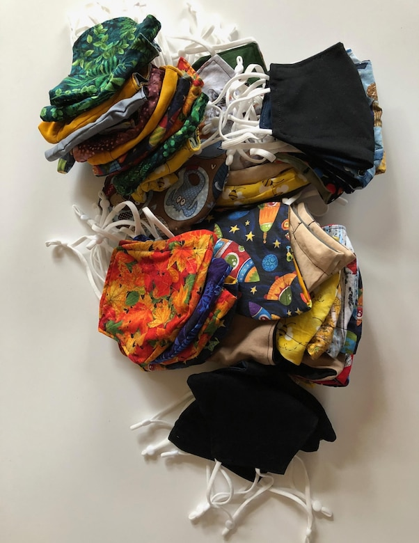 A collection of face coverings crafted by NSA's Sue Boyd. Ms. Boyd has created more than 1,000 face coverings to help combat COVID-19.