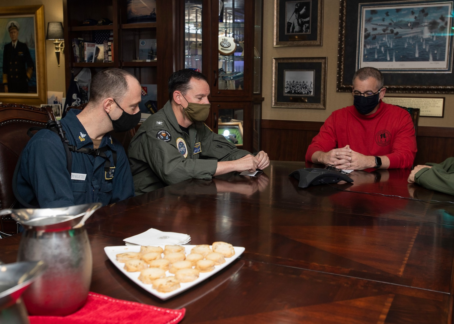 Rear Admiral Jim Kirk, commander, Carrier Strike Group 11 (right), Capt. Max Clark, commanding officer of the aircraft carrier USS Nimitz (CVN 68), and Chief Hull Technician (Select) Curtis Eicher participate in a phone call with Vice President Mike Pence aboard Nimitz. Nimitz, the flagship of Nimitz Carrier Strike Group, is deployed to the U.S. 5th Fleet area of operations to ensure maritime stability and security in the Central Region, connecting the Mediterranean and Pacific through the Western Indian Ocean and three critical chokepoints to the free flow of global commerce.
