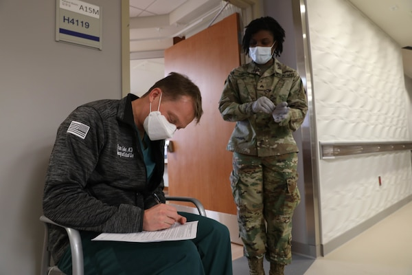 Lt. Col. Brian Cohee, a pulmonary and critical care physician assigned to the 121st Field Hospital, fills out paper work at Brian D. Allgood Army Community Hospital.