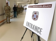 Service members stand in line to receive one of the first COVID-19 vaccines at Brian D. Allgood Army Community Hospital at U.S. Army Garrison Humphreys, South Korea Dec. 29, 2020.