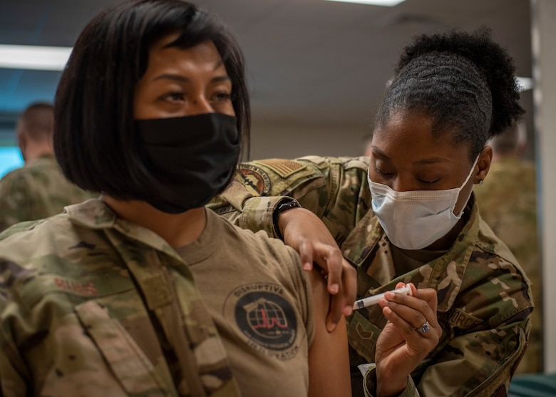 374th MDG administers initial COVID-19 vaccines