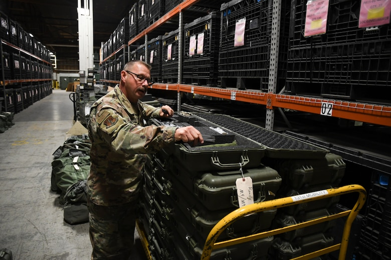 Master Sgt. Brian Bilbruck, a material management specialist with the 131st Logistics Readiness Squadron, inspects returned weapons cases during Unit Training Assembly November 14, 2020, at Whiteman Air Force Base, Missouri. (U.S. Air National Guard photo by Airman 1st Class Joseph Geldermann)