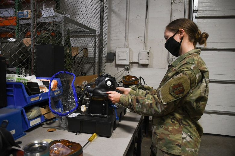 Staff Sgt. Dariyn Olas, a material management specialist with 131st LRS tests the integrity of an M-50 general purpose gas mask. (U.S. Air National Guard photo by Airman 1st Class Joseph Geldermann)