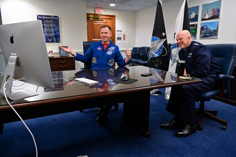 Chief of Space Operations Gen. John W. Raymond, right, and Air Force astronaut Col. Nick Hague speak with third grade students from Desoto Intermediate School in Adel, Iowa, during a virtual call at the Pentagon, Arlington, Va.