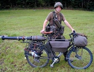 Agility and lethality. A Swiss soldier poses with his MOdell-93 bicycle, circa 1999. One could expect ROK forces would carry a similar load in the mountain trails of the ROK.