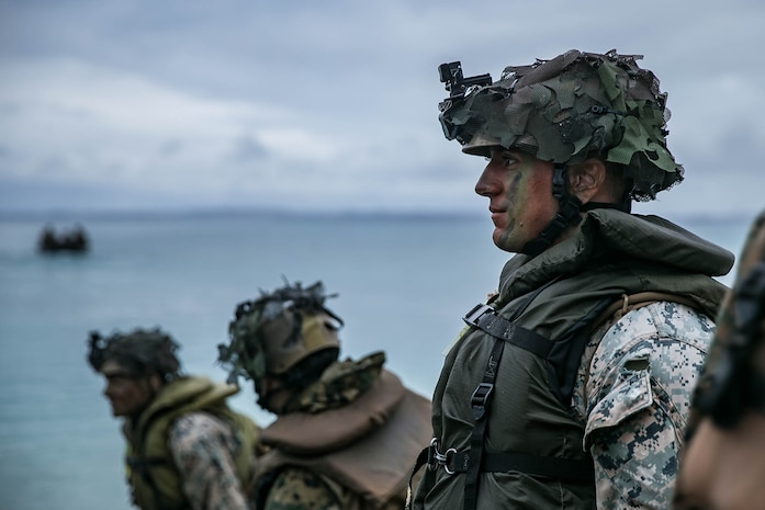 Marines with Kilo Company, BLT 3/4, 31st MEU prepare for a night boat raid during MEU Exercise at Kin Red, Okinawa, Japan, Dec. 16, 2020.