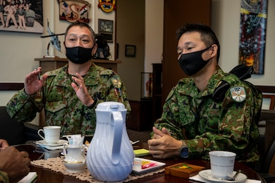 Japan Ground Self Defense Force (JGSDF), with 22nd Rapid Deployment Regiment, discuss during a tour at Marine Corps Air Station Futenma, Okinawa, Japan, Nov. 4, 2020. The tour was an opportunity for the JGSDF to conduct a site survey to familiarize themselves with MCAS Futenma's capabilities. (U.S. Marine Corps photo by Lance Cpl. Zachary Larsen)