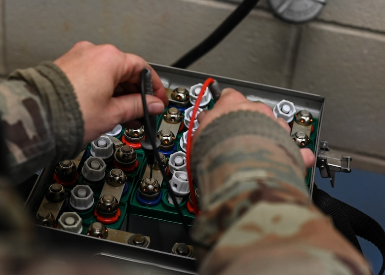 Senior Airman Jayme Bradley, an electrical and environmental specialist for the 175th Maintenance Squadron, Maryland National Guard, tests the batteries of an A-10C Thunderbolt II aircraft Dec. 18, 2020 at the Warfield Air National Guard Base at Martin State Airport, Middle River, Md.