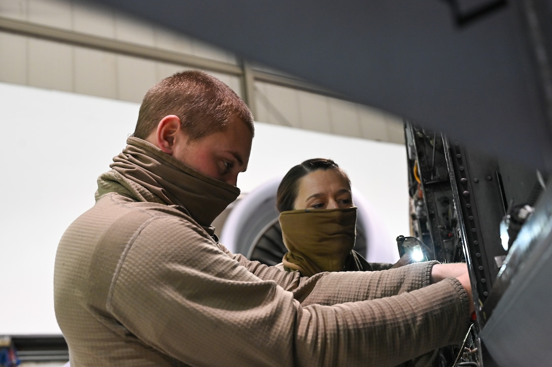 (From left) Staff Sgt. William Klingenstein and Senior Airman Jayme Bradley, both electrical and environmental specialists for the 175th Maintenance Squadron, Maryland National Guard, work on electrical components of an A-10C Thunderbolt II aircraft Dec. 23, 2020 at the Warfield Air National Guard Base at Martin State Airport, Middle River, Md.