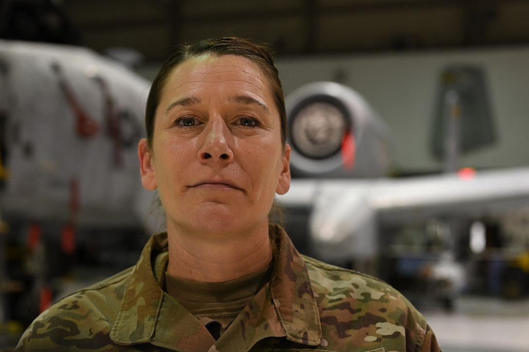 Senior Airman Jayme Bradley, an electrical and environmental specialist for the 175th Maintenance Squadron, Maryland National Guard, poses in front of an A-10C Thunderbolt II aircraft Dec. 18, 2020 at the Warfield Air National Guard Base at Martin State Airport, Middle River, Md.