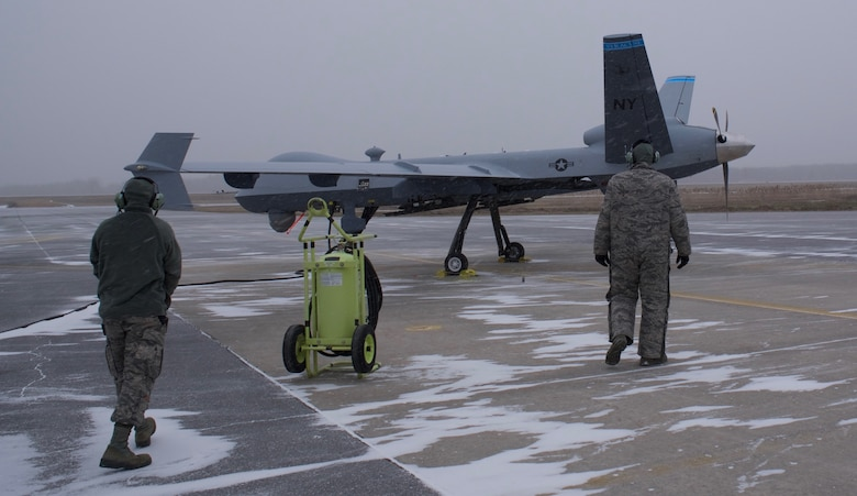 Members of the 174th Maintenance Group prepare to taxi the first Block 5 MQ-9 Reaper on Feb., 12, 2019, at Hancock Field Air National Guard Base in  Syracuse, N.Y. A Block 5 is an updated version of the MQ-9 that allows upgraded  communication and electrical systems.
