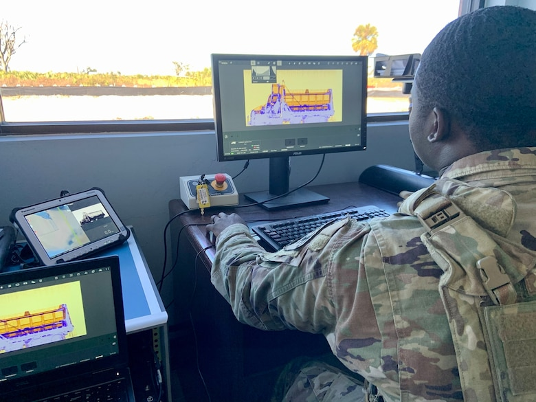 Senior Airman Norman Shoemake, 325th Security Forces Squadron search specialist, reviews x-ray images of commercial vehicles seeking access to Tyndall AFB.