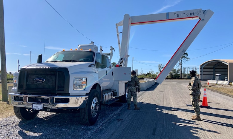 Senior Airmen Qwuantez Harris and Norman Shoemake, 325th Security Forces Squadron search specialists, deploy the Air Force's first Mobile Vehicle Access Control Inspection System, or VACIS M6500, at the Tyndall AFB Cleveland gate.