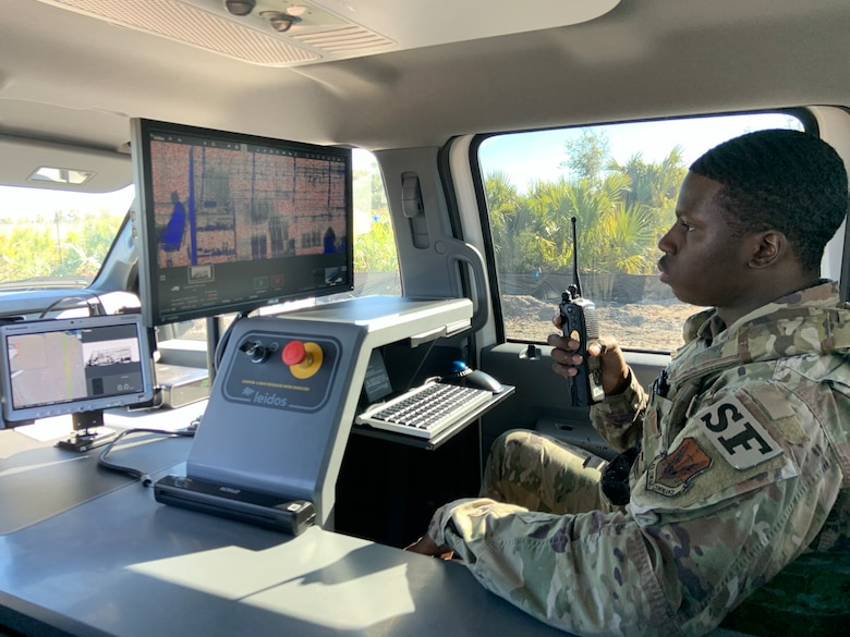 Senior Airman Norman Shoemake, 325th Security Forces Squadron search specialist, gives the all-clear to an incoming commercial vehicle after reviewing an x-ray of the vehicle and its cargo.