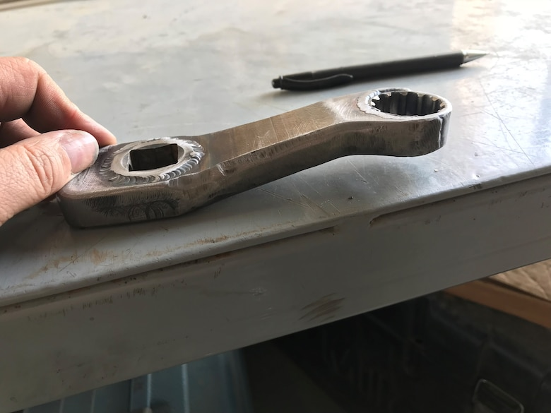 Aircraft metals technology craftsmen from the 148th Fighter Wing designed and fabricated tools, like this dog-leg wrench which was not available commercially, during a deployment to the 407th Air Expeditionary Group, Ahmad al-Jaber Air Base, Kuwait in 2018.