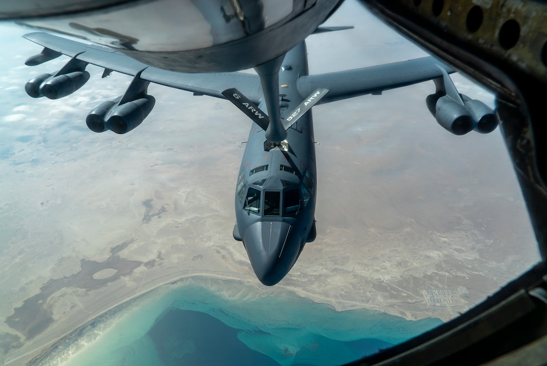 A U.S. Air Force B-52 from Barksdale Air Force Base is aerial refueled by a KC-135 Stratotanker over the U.S. Central Command area of responsibility Dec. 30, 2020. The B-52 Stratofortress is a long-range, heavy bomber that is capable of flying at high subsonic speeds at altitudes of up to 50,000 feet and can carry nuclear or precision guided conventional ordnance with global reach precision navigation capability. (U.S. Air Force photo by Senior Airman Roslyn Ward)