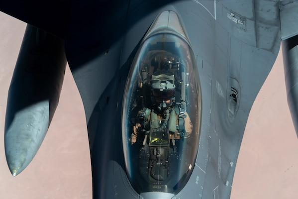 """U.S. Air Force F-16 Fighting Falcon is aerial refueled by a KC-135 """"Stratotanker"""" over the U.S. Central Command area of responsibility Dec. 30, 2020 as part of an escort mission in support of the B-52 """"Stratofortress"""" deployment. The short-notice deployment underscores the U.S. military's commitment to regional security and demonstrates a unique ability to rapidly deploy overwhelming combat power on short notice.  The B-52H is a long-range, heavy bomber that is capable of flying at high subsonic speeds at altitudes of up to 50,000 feet and provides the United States with immediate global strike capability.  (U.S. Air Force photo by Senior Airman Roslyn Ward)"""