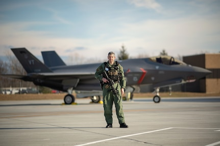 James Sides stands for a portrait in front of an F-35A Lightning II Joint Strike Fighter at the Vermont Air National Guard base, South Burlington, Vermont, Dec 3, 2020. Sides was recently named Air National Guard security forces flight level civilian supervisor of the year for 2020. Sides is a security operations supervisor with the 158th Security Forces Squadron.